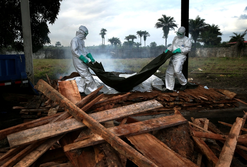 A Liberia Ministry of Health team unloaded the bodies of Ebola victims for a funeral pyre in Marshall, Liberia, on Friday Source: Two New Cases of Ebola Stem From Secondhand Contact, August 22, 2014